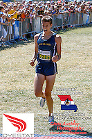 O'Fallon Township (Ill.) High School senior Patrick Perrier reacts as he finishes a victory run in the Forest Park Cross Country Festival's Varsity Boys Green 5k Race in a meet record time of 15:03, Saturday, September 14, 2013 in St. Louis' Forest Park.