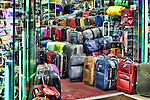 A colorful HDR of a luggage store on New York City's Times Square.