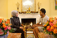 First Lady Michelle Obama meets with Ermine Erdogan, wife of the Prime Minister of Turkey,  in the Yellow Oval Room of the White House,  Dec. 8, 2009. (Official White House Photo by Samantha Appleton)<br /> <br /> This official White House photograph is being made available only for publication by news organizations and/or for personal use printing by the subject(s) of the photograph. The photograph may not be manipulated in any way and may not be used in commercial or political materials, advertisements, emails, products, promotions that in any way suggests approval or endorsement of the President, the First Family, or the White House.