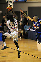 Giants import Rod Grizzard lays a shot up under pressure from Lindsay Tait. NBL Semifinal - Wellington Saints v Nelson Giants at TSB Bank Arena, Wellington, New Zealand on Friday, 15 July 2011. Photo: Dave Lintott / lintottphoto.co.nz