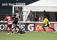 Bill Hamid #28 of D.C. United watches a shot by Eric Alexander #24 of FC Dallas hit home for a goal during an MLS match at RFK Stadium in Washington D.C. on August 14 2010. Dallas won 3-1.