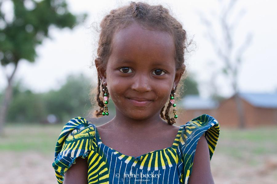 Fulani girl in front of her home in Kajuru village, Kaduna State, Nigeria.