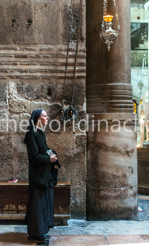 ISRAEL,Jerusalem, a nun is standing next to the Holy Sepulchre