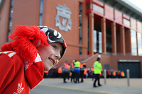 1st February 2020; Anfield, Liverpool, Merseyside, England; English Premier League Football, Liverpool versus Southampton; a young Liverpool fan eagerly awaits the arrival of the team bus in Anfield Road
