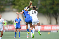 Seattle, WA - Saturday June 24, 2017: Katlyn Johnson, Brittany Taylor during a regular season National Women's Soccer League (NWSL) match between the Seattle Reign FC and FC Kansas City at Memorial Stadium.