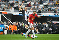 Juan Mata of Man Utd & Ciaran Clark of Newcastle United during the Premier League match between Newcastle United and Manchester United at St. James's Park, Newcastle, England on 6 October 2019. Photo by J GILL / PRiME Media Images.