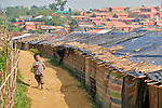 A boy runs through the Jamtoli Refugee Camp near Cox's Bazar, Bangladesh. More than 600,000 Rohingya refugees have fled government-sanctioned violence in Myanmar for safety in this and other camps in Bangladesh.