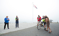 26 SEP 2013 - LANDS END, GBR - Judith Martin is wished good luck by Murray James, one of her support crew, as she waits to start the bike for the Enduroman 2013 Lands End to London to Dover ultra triathlon at Lands End, Sennen, Cornwall, Great Britain (PHOTO COPYRIGHT © 2013 NIGEL FARROW, ALL RIGHTS RESERVED)