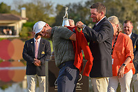 Arnold Palmer's grandson, Sam Saunders (USA) helps Francesco Molinari (ITA) don Arnie's red sweater following round 4 of the Arnold Palmer Invitational at Bay Hill Golf Club, Bay Hill, Florida. 3/10/2019.<br /> Picture: Golffile | Ken Murray<br /> <br /> <br /> All photo usage must carry mandatory copyright credit (© Golffile | Ken Murray)