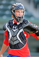 Catcher Kellin Deglan (23) of the Hickory Crawdads prior to a game against the Greenville Drive on April 9, 2012, at Fluor Field at the West End in Greenville, South Carolina. Deglan was a first-round pick by the Texas Rangers in the 2010 First-Year Player Draft and is the Rangers' No. 23 prospect, according to Baseball America. (Tom Priddy/Four Seam Images).
