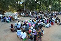 "Koh Lanta, Thailand--Esteemed Buddhist monk, Buddha Isara, addresses the villagers of Hua Laem after many of them lost their homes and fishing boats to the Tsunami on December 26th, 2004.  ""I know you are Muslims and I come to you not as a Monk but as a Thai,"" said Isara who pledged to supply the materials and experienced labor needed to repair the village's fishing boats.  In addition, Isara plans to live in the village for several weeks, primarily to send a message to the Thai government of peaceful resistance to the relocation plans. Within Thailand, Isara is seen as a modern-day Gandhi figure, thus giving the villagers a powerful voice. 01/31/05 © Julia Cumes / The Image Works"