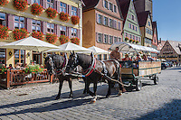 Germany, Bavaria, Middle Franconia, Dinkelsbuehl: sightseeing tour through historic old town in a horse-drawn carriage | Deutschland, Bayern, Mittelfranken, Dinkelsbuehl: mit der Pferdekutsche durch die historische Altstadt