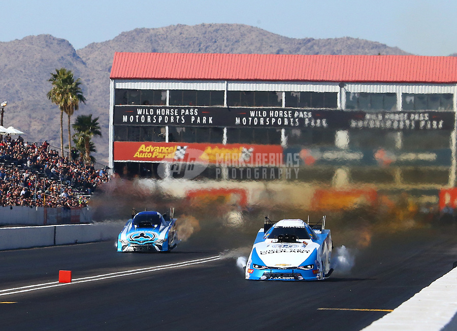 Feb 25, 2018; Chandler, AZ, USA; NHRA funny car driver John Force (right) prior to exploding the body off his car alongside Jonnie Lindberg  during the Arizona Nationals at Wild Horse Pass Motorsports Park. Mandatory Credit: Mark J. Rebilas-USA TODAY Sports
