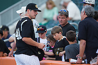Carlos Rodon (41) of the Charlotte Knights signs autographs prior to the game against the Norfolk Tides at BB&T BallPark on April 9, 2015 in Charlotte, North Carolina.  The Knights defeated the Tides 6-3.   (Brian Westerholt/Four Seam Images)
