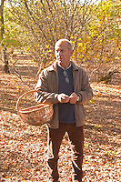 Hugues Martin, the owner of the truffles farm with a wicker basket to collect the truffles Truffiere de la Bergerie (Truffière) truffles farm Ste Foy de Longas Dordogne France