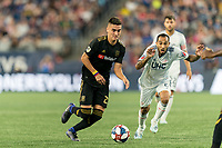 FOXBOROUGH, MA - AUGUST 4: Eduard Atuesta #20 of Los Angeles FC dribbles as Edgar Castillo #8 of New England Revolution closes during a game between Los Angeles FC and New England Revolution at Gillette Stadium on August 3, 2019 in Foxborough, Massachusetts.