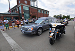 An Illinois State Police motorcade flanks the hearse as it passes by Waterloo City Hall where hundreds of residents gathered to pay their respects to fallen ISP Trooper Nick Hopkins. Dozens of police departments joined in the procession from St. Louis to Waterloo for slain Illinois State Police Trooper Nick Hopkins on Monday August 26, 2019. <br /> Photo by Tim Vizer