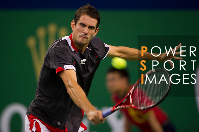 SHANGHAI, CHINA - OCTOBER 13:  Guillermo Garcia-Lopez of Spain returns a ball to Andy Roddick of USA during day three of the 2010 Shanghai Rolex Masters at the Shanghai Qi Zhong Tennis Center on October 13, 2010 in Shanghai, China.  (Photo by Victor Fraile/The Power of Sport Images) *** Local Caption *** Guillermo Garcia-Lopez