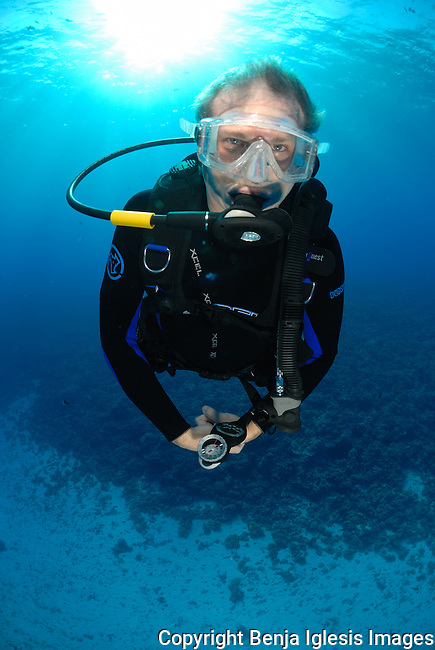 Diver doing safety stop at mid reef Molokini Maui Hawaii.