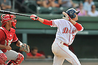 Shortstop Jeremy Rivera (35) of the Greenville Drive bats in a game against the Lakewood BlueClaws on Sunday, June 26, 2016, at Fluor Field at the West End in Greenville, South Carolina. The Lakewood catcher is Edgar Cabral. Greenville won, 2-1. (Tom Priddy/Four Seam Images)