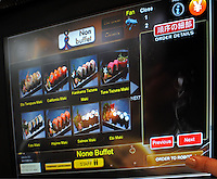 Customers order food in the Hajime Restaurant from touch panel and Samurai robot will bring ordered food to their table, Bangkok, Thailand. Hajime is a Japanese restaurant in Thailand, has samurai style robot serving food to the diners and even do a dance session to entertain guests. This robot are made in Japan and costed about 86,600,000 yen (1,063,717USD). <br />