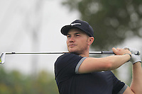 Oliver Fisher (ENG) tees off the par3 17th tee during Friday's Round 2 of the 2014 BMW Masters held at Lake Malaren, Shanghai, China 31st October 2014.<br /> Picture: Eoin Clarke www.golffile.ie