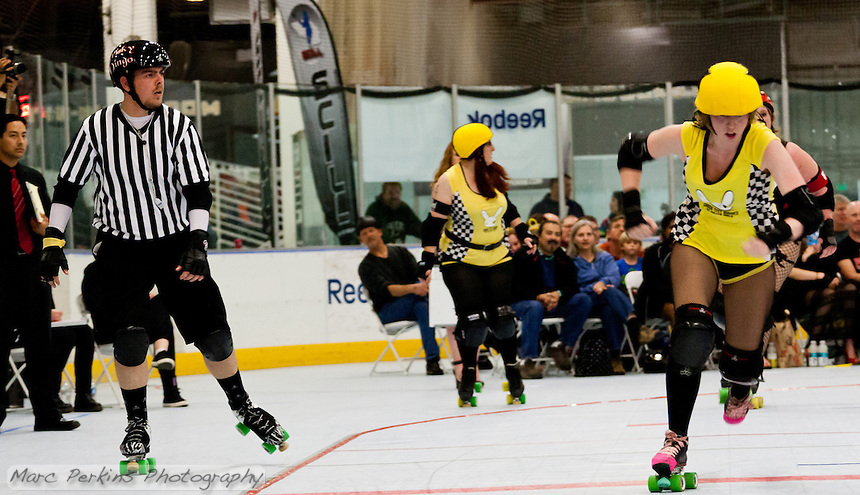 The jammer for the Crash Test Bunnies breaks free of the pack as outside pack referee Frisky Dingo watches.