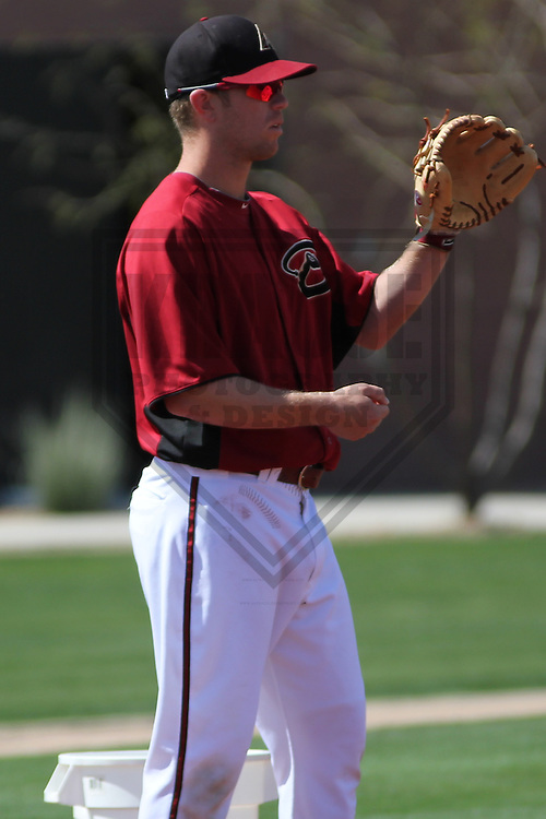 SCOTTSDALE - March 2013: Aaron Hill (2)  of the Arizona DiamondBacks during a Spring Training workout on March 19, 2013 at Salt River Fields in Scottsdale, Arizona.  (Photo by Brad Krause). .