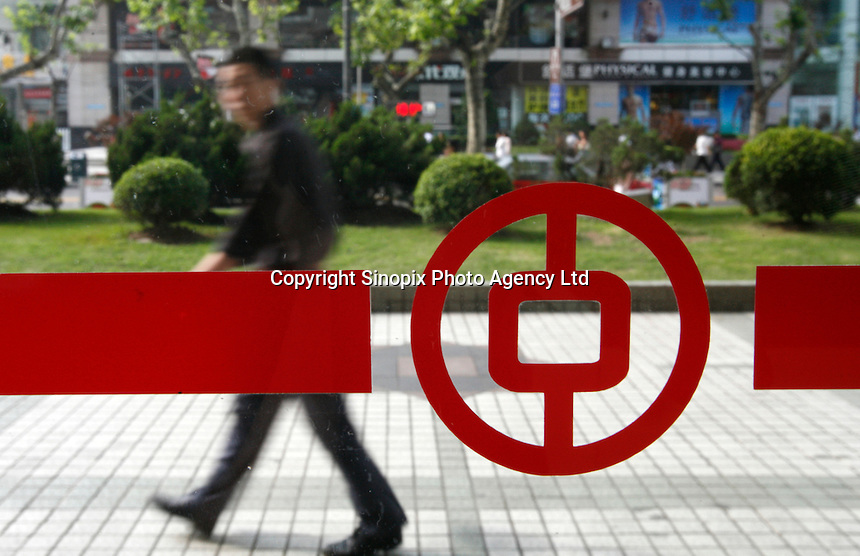 A man walks past a Bank of China branch in Shanghai, China..