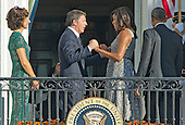 From left to right: Mrs. Agnese Landini; Prime Minister Matteo Renzi of Italy; first lady Michelle Obama; and United States President Barack Obama wave on the South Portico at the end of the Official Arrival Ceremony on the South Lawn of the the White House in Washington, DC on Tuesday, October 18, 2016.  <br /> Credit: Ron Sachs / CNP