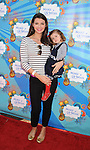 SANTA MONICA, CA. - March 14: Ali Landry and daughter Estela Monteverde attend the Make-A-Wish Foundation's Day of Fun hosted by Kevin & Steffiana James held at Santa Monica Pier on March 14, 2010 in Santa Monica, California.