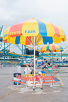 A view of the midway at the start of a rainy day at the Iowa State Fair in Des, Moines, Iowa, on Sun., Aug. 11, 2019.