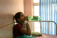 Patients drink water at the Medak District Hospital in Medak, Telangana, India.
