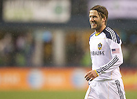 L.A. Galaxy midfielder David Beckham smiles after getting a yellow card during play against the Seattle Sounders FC at Qwest Field in Seattle Tuesday March 15, 2011. The Galaxy won the game 1-0.
