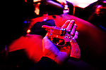 New York City, 2011. Giulia Bianchi, photographer, receive a toy gun as present at Barracuda gay club.