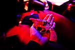 New York City, 2011. Giulia Bianchi, photographer, receive a toy gun as present at Barracuda gay club.