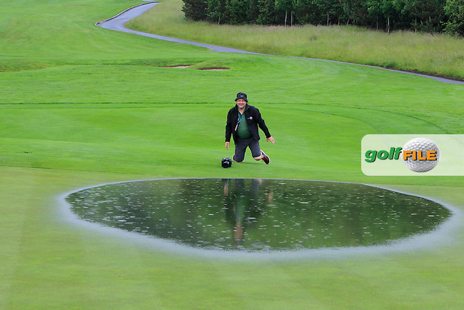 David Lloyd (Golffile) on the water logged 9th green during the suspension of play in the Saturday Afternoon Fourballs of the 2016 Curtis Cup at Dun Laoghaire Golf Club on Saturday 11th June 2016.<br /> Picture:  Golffile | Thos Caffrey