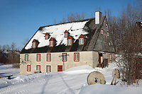 Moulin de la Chevrotiere, a mill built in French style in 1802 by by Lord Joseph Chavigny de la Chevrotiere, now used as an exhibition hall, in Deschambault, on the Chemin du Roy, Quebec, Canada. The Chemin du Roy or King's Highway is a historic road along the Saint Lawrence river built 1731-37, connecting communities between Quebec City and Montreal. The building is listed as a historic monument. Picture by Manuel Cohen