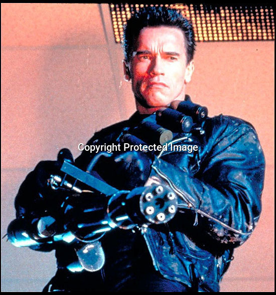 BNPS.co.uk (01202 558833)<br /> Pic: Heritage<br /> <br /> ***Please Use Full Byline***<br /> <br /> The jacket in action...<br /> <br /> The bullet-ridden biker jacket worn by Hollywood star Arnold Schwarzenegger as killer cyborg the Terminator is up for sale for &pound;10,000 <br /> <br /> Arnie donned the custom-made black leather jacket for his return to the classic role in the 1991 blockbuster smash Terminator 2: Judgement Day.<br /> <br /> The jacket is peppered with 'bullet holes' from a shoot-out with a rival cyborg early in the film as heroine Sarah Connor escapes from a hospital.<br /> <br /> It is being sold by Ron South, the film's second assistant director, who was given it when the production finished.<br /> <br /> It has been tipped to fetch upwards of 10,000 pounds when it goes under the hammer at Heritage Auctions in Dallas, Texas, on December 6.