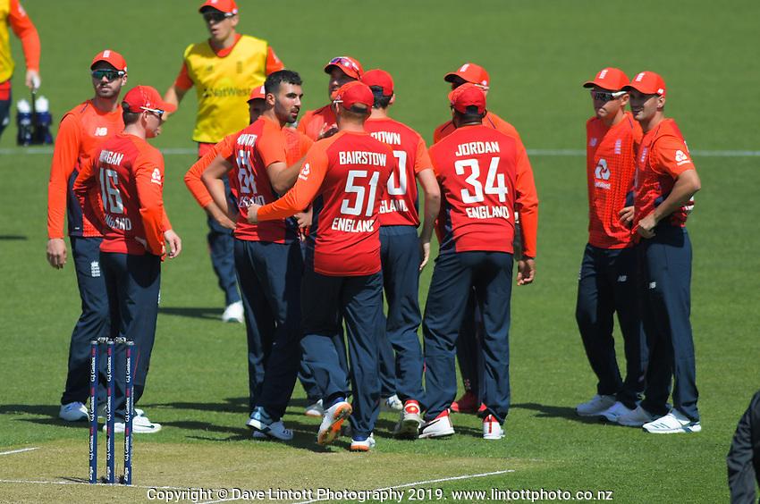 England's Saqib Mahmood celebrates dismissing Tim Seifert. Twenty20 International cricket match between NZ Black Caps and England at Westpac Stadium in Wellington, New Zealand on Sunday, 3 November 2019. Photo: Dave Lintott / lintottphoto.co.nz