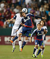 CARSON, CA – APRIL 30, 2011: Chivas USA midfielder Jorge Flores (19) heads the ball during the match between Chivas USA and New England Revolution at the Home Depot Center, April 30, 2011 in Carson, California. Final score Chivas USA 3, New England Revolution 0.