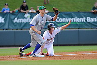 Third baseman Keaton Briscoe (11) of the Greenville Drive is tagged out at third by third baseman Hunter Dozier of the Lexington Legends as both players wait for the umpire's call on Monday, August 19, 2013, at Fluor Field at the West End in Greenville, South Carolina. Lexington won, 5-1. (Tom Priddy/Four Seam Images)