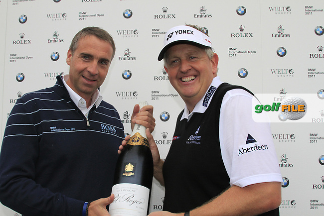 Colin Montgomerie (SCO) gets a present of a bottle of champagne from Marco Kaussler BMW on his birthday during Day 1 of the BMW International Open at Golf Club Munchen Eichenried, Germany, 23rd June 2011 (Photo Eoin Clarke/www.golffile.ie)