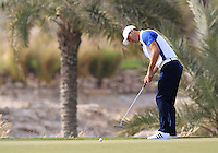 Martin Kaymer (GER) putts on the 12th green during Sunday's Final Round of the Commercial Bank Qatar Masters 2013 at Doha Golf Club, Doha, Qatar 26th January 2013 .Photo Eoin Clarke/www.golffile.ie