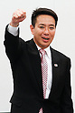 August 26, 2011, Tokyo, Japan - Japans former Foreign Minister Seiji Maehara thrusts his clenched fist in a gesture of encouragement during a pep rally with his fellow Democrat lawmakers after Prime Minister Naoto Kan announced his resignation on Friday, August 26, 2011. Kans departure will pave the way for the ruling Democratic Party of Japan to select his successor in a race among seven mediocre candidates slated for August 29. Maehara is favored in the election for the party leadership and that of the country - sixth in five years. (Photo by AFLO)