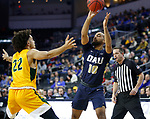 SIOUX FALLS, SD - MARCH 8: Sam Kearns #10 of the Oral Roberts Golden Eagles passes the ball while being guarded by Cameron Hunter #22 of the North Dakota State Bison at the 2020 Summit League Basketball Championship in Sioux Falls, SD. (Photo by Richard Carlson/Inertia)