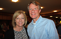 NWA Democrat-Gazette/CARIN SCHOPPMEYER Laura and Bruce Wilkins enjoy the reception at the Greenwoods'.