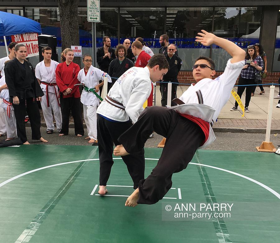 Merrick, New York, USA. 27th September 2015. Two students of Goshinkan Jujitsu Dojo Family Self Defense Center demonstrate jujitsu moves at the Merrick Fall Festival