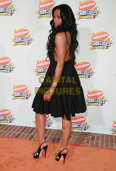 CIARA.20th Annual Nickelodeon Kids' Choice Awards held at UCLA's Pauley Pavilion, Westwood, California, USA..March 31s, 2007.full length looking over shoulder shoes black dress .CAP/ADM/CH.©Charles Harris/AdMedia/Capital Pictures