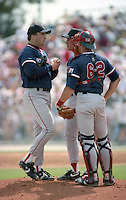 Boston Red Sox pitcher Jeff Plympton talks with manager Butch Hobson and catcher John Flaherty (62)  during spring training circa 1992 at Dunedin Stadium in Dunedin, Florida.  (MJA/Four Seam Images)